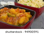 Sweet and Sour Chicken & Egg Fried Rice - Chinese sweet and sour chicken served egg fried rice and prawn crackers. - stock photo