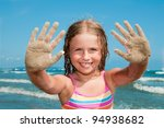 Summer vacation - lovely  girl playing on sandy beach - stock photo