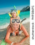 Summer vacation - snorkeling with mother - stock photo