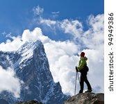 Young Woman Hiker Trekking In...