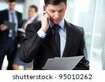 businessman answering a call... | Shutterstock . vector #95010262