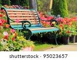 vintage bench in tulips garden