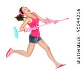 Cleaning woman jumping happy excited during spring cleaning fun. Funny energetic beautiful girl with cleaning broom playing air guitar isolated on white background. Multiracial Caucasian / Asian model - stock photo