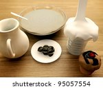 cream and chocolate on wooden table - stock photo