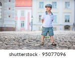 Portrait of a little 3 years old boy outdoors in city - stock photo