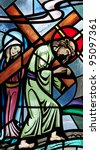 Stained glass window of Jesus Christ carrying the cross - stock photo
