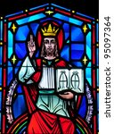Small photo of Stained glass window of Christ the King, Alpha and Omega