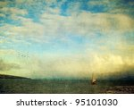 Scenic seascape with a wooden boat, birds and interesting clouds with a texture layer for a painterly look. - stock photo