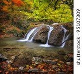 Waterfall In The Autumn In The...