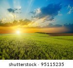 Sunset Over Agricultural Green...