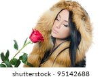 Girl with beautiful hair with red rose - stock photo