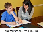 Tutor Helping A Young Student...