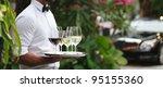 tuxedo dressed waiter serving... | Shutterstock . vector #95155360