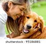 Stock photo cute portrait of a woman with her dog at the park 95186881