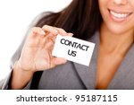 Woman displaying a contact us business card - isolated over a white background - stock photo