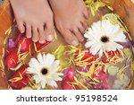 dipping feet inside a bowl full ... | Shutterstock . vector #95198524