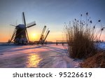 Stock photo winter windmill at sunset between abcoude and baambrugge in the netherlands near amsterdam 95226619