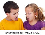 Kids with bad behavior - mocking each other with tongues sticking out, closeup - stock photo