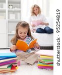 Shaping the habit of reading in kids - teaching by example - stock photo