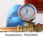 Temperature and pressure gauge mounted on boiler pipes - stock photo