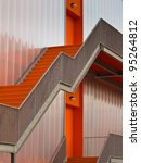 Orange escape stairs on the outside of a modern building - stock photo