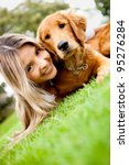 Stock photo girl with a cute puppy dog outdoors 95276284