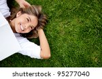 woman relaxing outdoors looking ... | Shutterstock . vector #95277040