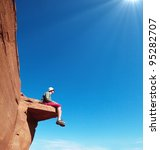 Man on the cliff in Glen Canyon - stock photo