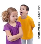 Upset little girl bullied and mocked by older boy - isolated - stock photo