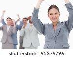 cheering tradeswoman with team...   Shutterstock . vector #95379796