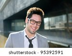 Portrait of a handsome young businessman laughing - stock photo