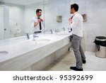 man getting dressed in a public ... | Shutterstock . vector #95392699
