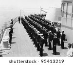 Sailors at attention on naval ship - stock photo