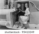 Portrait of woman in car - stock photo