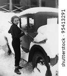 Woman Shoveling Snow Off Car