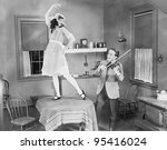 Man Playing Violin For Woman...