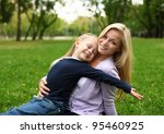 young mother playing with... | Shutterstock . vector #95460925