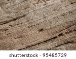 Stone texture of an ancient natural rock with reflection in the water - stock photo