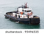 A Tug Boat Stands Ready To Hel...