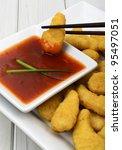 Crispy Chicken & Sweet and Sour Dip - Oriental crispy chicken with a sweet and sour/chilli dip. - stock photo