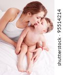 happy young mother and her two... | Shutterstock . vector #95514214