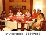 Chinese Family In Dinner Room