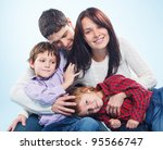 cute happy family of a four in... | Shutterstock . vector #95566747