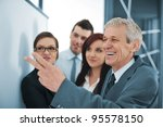 boss explaining graph to his... | Shutterstock . vector #95578150