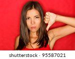 Unhappy Woman Giving Thumbs...
