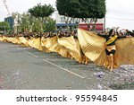 LIMASSOL, CYPRUS - MARCH 6, 2011: Unidentified participants in Egyptian costums during the carnival parade, established in 16th century, influenced by Venetians. - stock photo