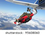 skydiver jumps from an airplane | Shutterstock . vector #95608060