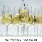 Glasses Of Champagne On White...
