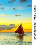 Sailboat Against A Orange...