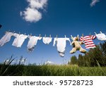 baby clothing and a teddybear... | Shutterstock . vector #95728723
